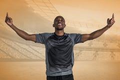 愉快的运动员的综合图象有胳膊的在胜利以后上升了 免版税库存照片