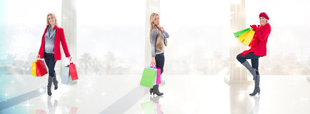 愉快的金发碧眼的女人的综合图象在冬天给拿着购物袋穿衣 免版税库存照片