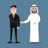 愉快的阿拉伯握手的人和西部商人 库存图片