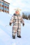 愉快的17个月婴孩在天空看在冬天 免版税库存照片