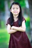 愉快的年轻亚裔女孩 免版税图库摄影