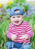 愉快的婴孩在夏天 库存照片