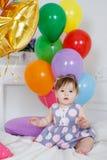 愉快的婴孩在他的第一个生日 免版税图库摄影