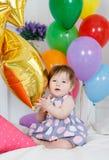 愉快的婴孩在他的第一个生日 图库摄影