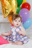 愉快的婴孩在他的第一个生日 免版税库存照片