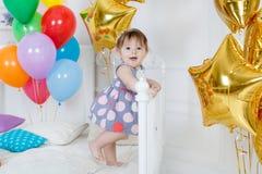 愉快的婴孩在他的第一个生日 库存图片
