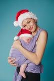 愉快的婴孩她的母亲 免版税库存照片