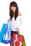 愉快的购物妇女 免版税库存图片