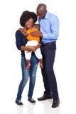 年轻非洲家庭 库存照片