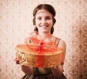 愉快礼品的女孩 库存图片