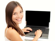 愉快膝上型计算机的妇女 库存照片