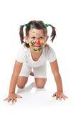 愉快逗人喜爱的表面的女孩被绘的一&# 免版税库存照片