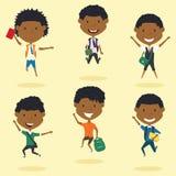 愉快非裔美国人男生跳跃室外 图库摄影