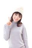 愉快,微笑,快乐的妇女佩带的编织帽子,显示1个手指 库存图片