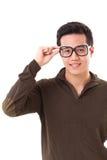 愉快,正面,聪明的天才书呆子或怪杰人戴眼镜 免版税库存图片