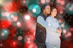愉快年轻夫妇拥抱的综合图象 免版税库存照片
