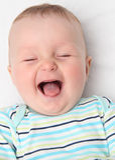 愉快婴孩笑 免版税库存图片