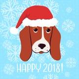 愉快2018导航新年与狗的贺卡在圣诞节帽子 库存图片
