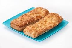 意大利三明治用在蓝色板材的乳酪 库存图片