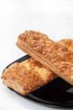 意大利三明治用在黑暗的板材的乳酪 免版税库存照片