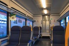意大利地方火车内部,旅行到莱科镇 库存照片