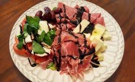 意大利开胃小菜板材  免版税库存图片