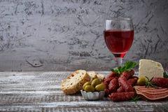 意大利开胃菜的选择 酒快餐集合 库存图片