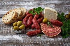 意大利开胃菜的选择 酒快餐集合 图库摄影