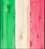 意大利旗子的被弄脏的木头 图库摄影