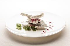 创造性的意大利烹调: 乳脂状的鳕鱼点心 库存照片