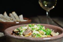 意大利煨饭和辣香肠 图库摄影