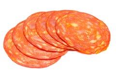 意大利蒜味咸腊肠或西班牙加调料的口利左香肠在白色背景 库存图片