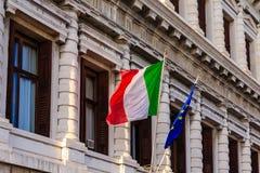 意大利语和欧盟旗子 库存图片