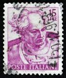 意大利邮票由Michelangio显示乔尔,在西斯廷教堂的壁画的头,大约1961年 库存照片