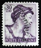 意大利邮票由Michelangio显示女巫厄立特里亚,在西斯廷教堂的壁画,大约1961年 库存图片