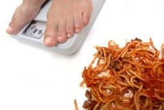 意大利面食缩放比例妇女 库存照片