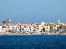 意大利,撒丁岛,波尔托斯库索,口岸的看法从海的 图库摄影