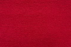 意想不到的在宏指令的对比红色纺织品背景 免版税库存图片