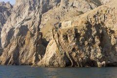 意想不到的形成在一个古老火山卡拉Dag的岩石看 免版税库存图片