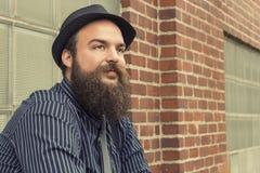 满意的有胡子的人 免版税库存图片