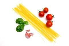 意粉用蕃茄和蓬蒿 免版税库存图片