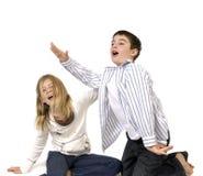 愚蠢男孩的女孩 免版税库存图片