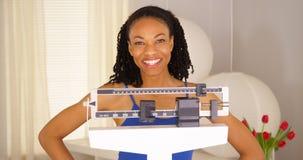 感到非洲的妇女非常感到骄傲为她自己 免版税库存照片