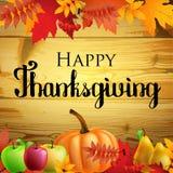 感恩与叶子的贺卡,在木背景的南瓜 免版税库存照片