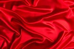 感觉上背景红色的缎使光滑 库存图片