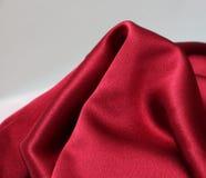 感觉上背景红色的缎使光滑 库存照片