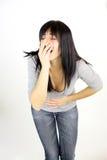 感觉可怕的肚子疼月经痛苦的妇女 免版税库存照片