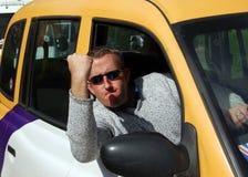 愤怒的出租车司机 免版税库存照片