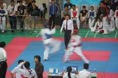 愤怒的跆拳道竞争在深圳 免版税图库摄影