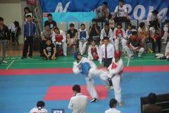 愤怒的跆拳道竞争在深圳 免版税库存照片